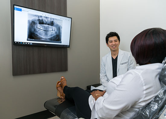 Dr. Tristan Cheung Discussing Treatment with a Patient