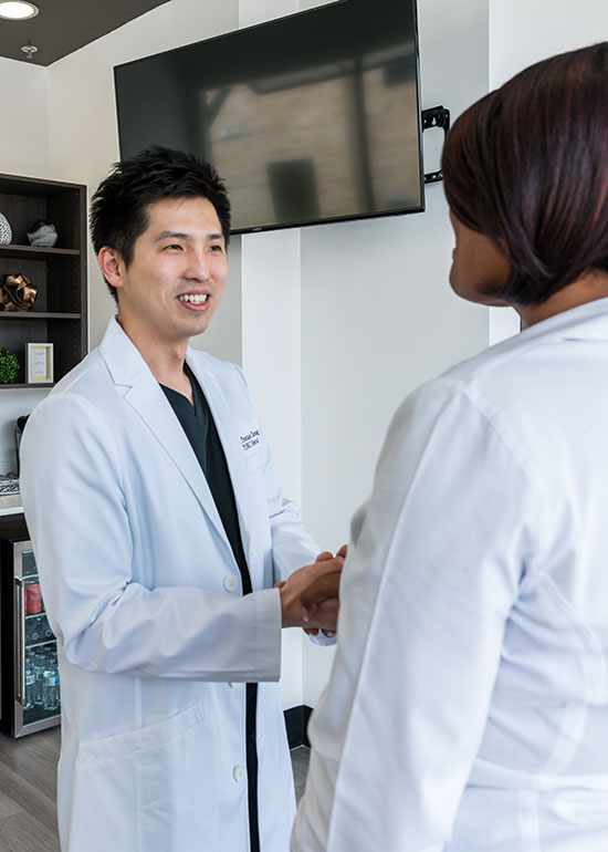 Dr. Tristan Cheung Welcomes a Patient